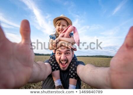 vader · zoon · armen · witte · gezicht · portret - stockfoto © RuslanOmega