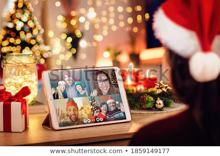 Happy family in Christmas costumes  Stock photo © dacasdo
