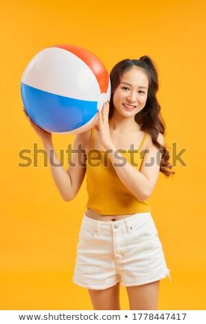 holding a ball stock photo © pedromonteiro