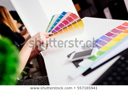 woman Choosing color from color scale Stock photo © stokkete