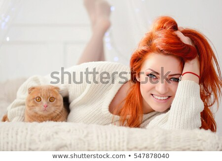 red haired girl in bed with gift stock photo © massonforstock