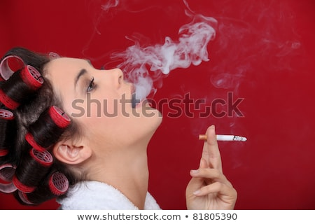 Female smoker exhaling puffs of smoke Stock photo © photography33