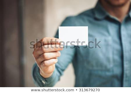 férfi · mutat · névjegy · felirat · fiatal · lezser - stock fotó © Maridav