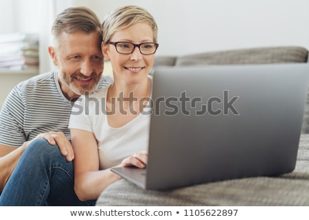 Middle-aged couple looking at their laptop Stock photo © photography33