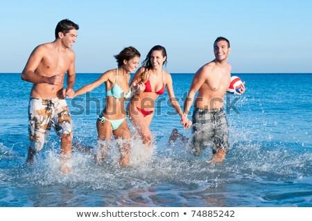 Foto stock: Casal · praia · jogar · bola · prestados · alto