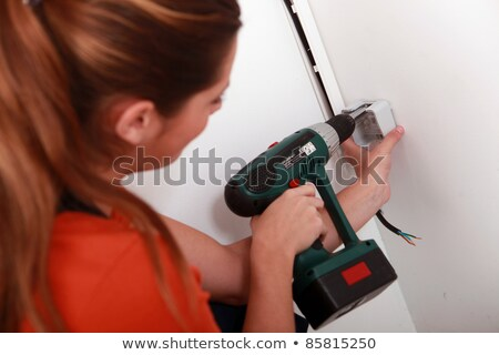 woman concealing wiring stock photo © photography33
