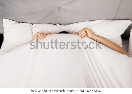 Stock photo: Scared man hiding in bed
