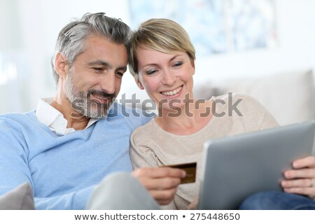Two middle aged women online shopping. Stock photo © photography33