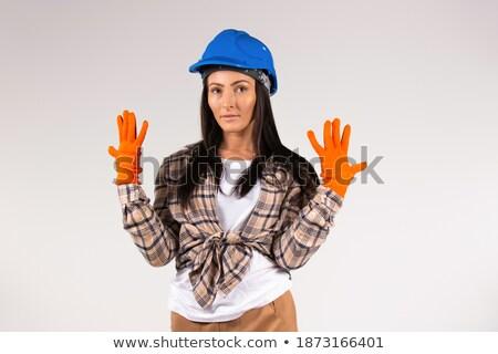 A pensive tradeswoman Stock photo © photography33