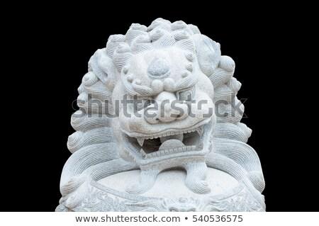 Chinês leão estátua sessão fora cultura Foto stock © oscarcwilliams