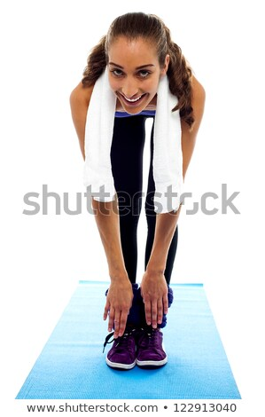 Flexible woman bending down till toes Stock photo © stockyimages