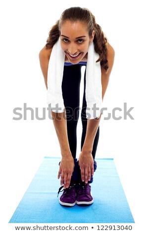 Rugalmas nő görbület lefelé lábujjak izolált Stock fotó © stockyimages