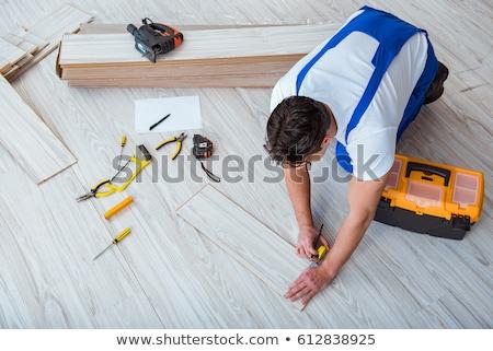 Man sawing laminate flooring Stock photo © photography33
