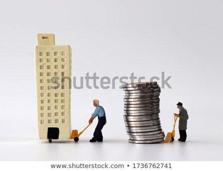 Business man carrying a cart with a lot of money Stock photo © davisales