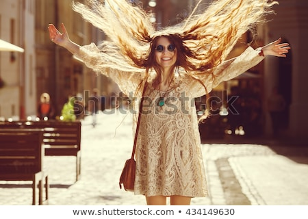 fashion photo of beautiful young woman in lace dress smiling stock photo © pawelsierakowski