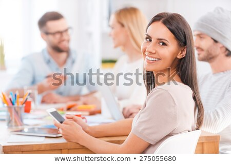 Woman feeling her shoulder while looking at camera Stock photo © wavebreak_media