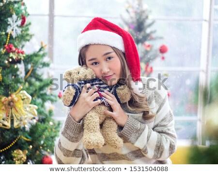 Smiling woman holding a teddy bear Stock photo © wavebreak_media