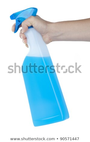 Hand squirting a bottle of cleaning spray isolated on white stock photo © alexandkz