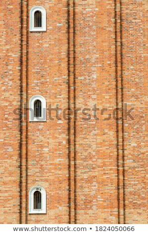 Clock on the wall of the house at St. Mark's Square. Stock photo © Pilgrimego