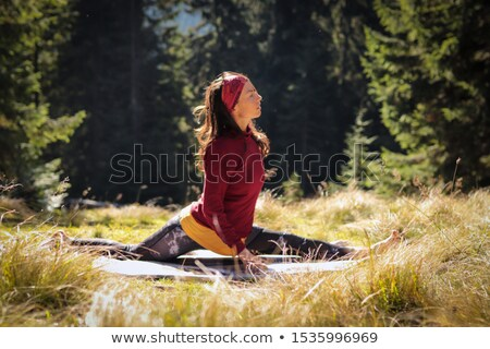 Genç kız yoga uzun saçlı kırmızı elbise Stok fotoğraf © doupix