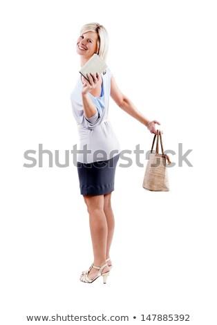 aantrekkelijk · geslaagd · vrouw · hand · zak · portemonnee - stockfoto © justinb