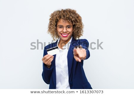 Smiling woman indicating towards credit card Stock photo © stockyimages