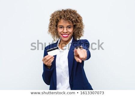 Stock photo: Smiling woman indicating towards credit card