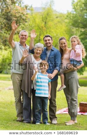familia · manos · sesión · parque · hierba - foto stock © get4net