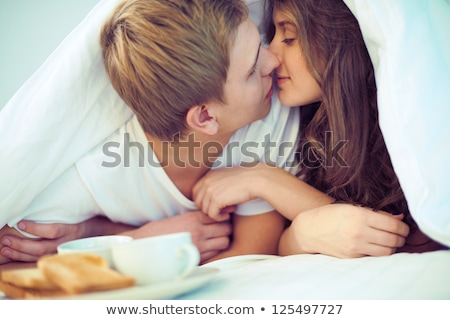 romantic couple kissing and cuddling stock photo © stryjek