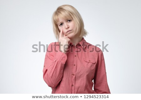 Sulking young girl with tears in her eyes Stock photo © ilona75