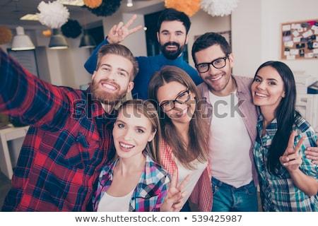 Attractive group of friends with signs Stock photo © konradbak