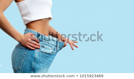 Woman in dieting concept with big jeans Stock photo © Elnur