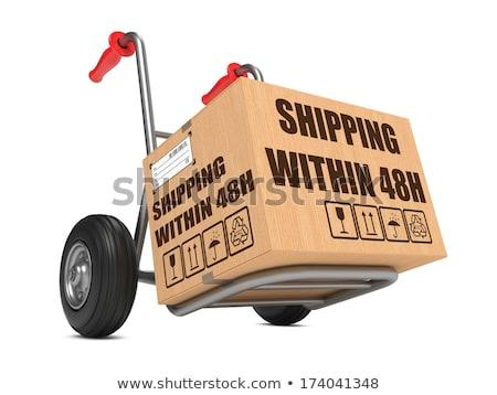 Shipping within 48h - Cardboard Box on Hand Truck. Stock photo © tashatuvango