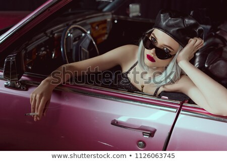 Young blonde woman in vintage clothing holding sigarette Stock photo © avdveen