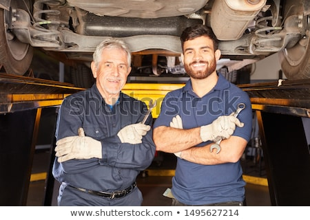 Cars masters and apprentices in the workshop Stock photo © runzelkorn