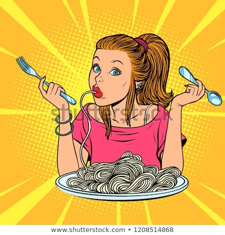Woman eating spaghetti in the kitchen at home Stock photo © dashapetrenko