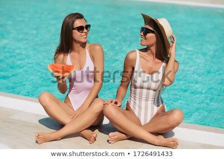 Hosszú hajú lány bikini fektet napozás trópusi tengerpart Stock fotó © HASLOO