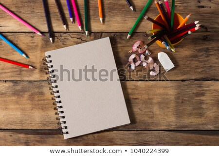 blank paper and colorful pencils on the wooden table stock photo © karandaev