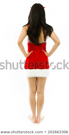 rear view of a young asian woman standing with her arms akimbo stock photo © bmonteny