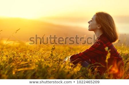 シルエット 若者 座って ビーチ 見える 日没 ストックフォト © Nejron