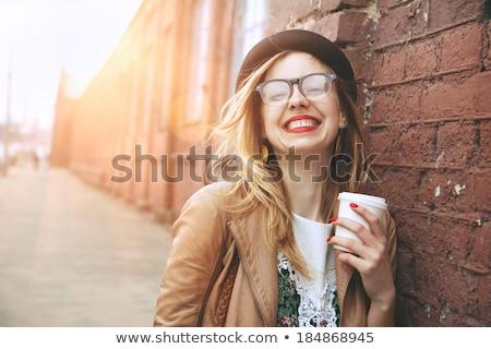 Smiling pretty woman enjoying morning coffee Stock photo © dash
