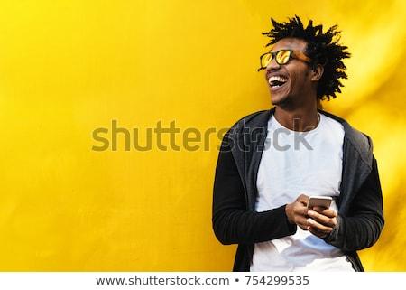 afrikai · férfi · küldés · üzenet · közelkép · mobiltelefon - stock fotó © stockyimages