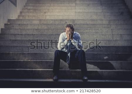 Broke business man Stock photo © phakimata