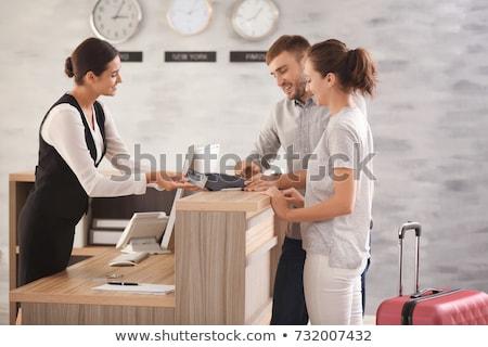 Hôtel réception réceptionniste travaux lieu femme Photo stock © Vg