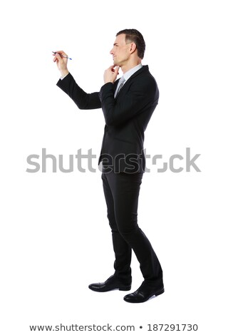 Full-length portrait of a businessman writes with pen at copyspace over white background Stock photo © deandrobot