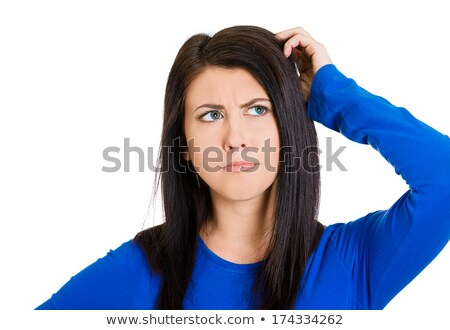 Stock photo: woman scratching head, thinking daydreaming confused