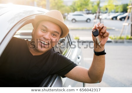 happy young asian man smiling showing keys of new car stock photo © diego_cervo