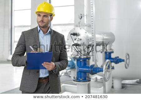 male supervisor writing on clipboard stock photo © wavebreak_media