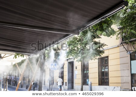Stock photo: Water vapor fun in summer heat.
