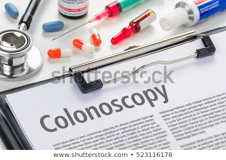 The diagnosis Colon Cancer written on a clipboard Stock photo © Zerbor